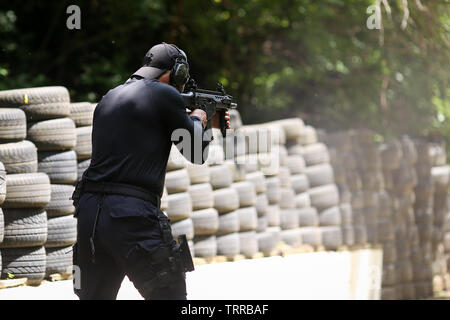 Bucharest, Romania - June 10, 2019: a Romanian SIAS (equivalent of SWAT in the US) police officer trains in a shooting range. - Stock Photo