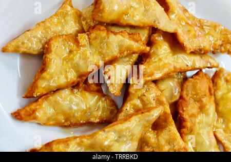 Thai Cuisine and Food, Close Up Goong Gra Buang or Crispy Shrimp Pancakes Stuffed with Prawns and Pork. - Stock Photo