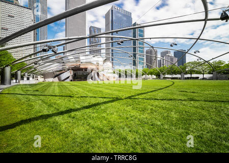Jay Pritzker Pavilion is located within Millenium Park in downtown Chicago. The location is open to the public and features theater and musical acts. - Stock Photo