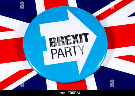 London, UK - May 29th 2019: A pin badge for the Brexit Party, pictured over the UK flag.  The Brexit Party are a UK political party led by Nigel Farag - Stock Photo