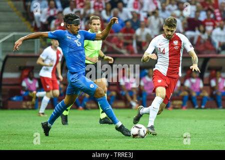 WARSAW, POLAND - JUNE 10, 2019: Qualifications Euro 2020  match Poland - Israel 4:0. In action Dor Peretz (L) and Mateusz Klich (R). - Stock Photo