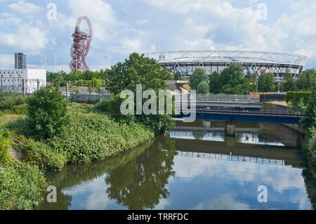 The River Lea at London Olympic Park, with the London Stadium and the ArcelorMittal Orbit in background - Stock Photo