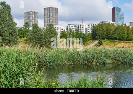 East Village at Stratford, East London UK, viewed from the banks of the River Lea in the London Olympic Park - Stock Photo