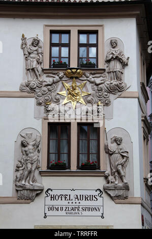 Restored exterior of the historic Hotel Aurus building in Prague - Stock Photo