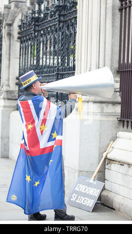 London, UK. 11th June 2019. Mr Stop Brexit, Steve Bray, an activist from Port Talbot, southern Wales, on his daily protest around the Houses of Parliament, London, UK, making his loud anti-Brexit message with a large cone-shaped speaking trumpet. Credit: Joe Kuis / Alamy News - Stock Photo