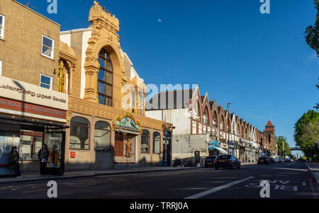 London, England, UK - May 14, 2019: Evening sun lights up the Murugan Hindu Temple in Highgate Hill in North London. - Stock Photo