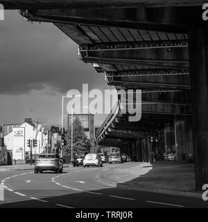 London, England, UK - May 4, 2019: Traffic flows on the Great West Road under the M4 motorway Chiswick Flyover in Brentford, West London. - Stock Photo
