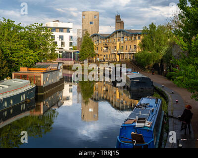 London, England, UK - May 2, 2019: Houseboats are moored in the Grand Union Canal at Ladbroke Grove in west London. - Stock Photo