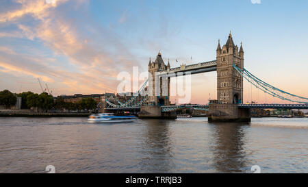 London, England, UK - September 27, 2018: Clouds light up over London's iconic Tower Bridge at sunset.