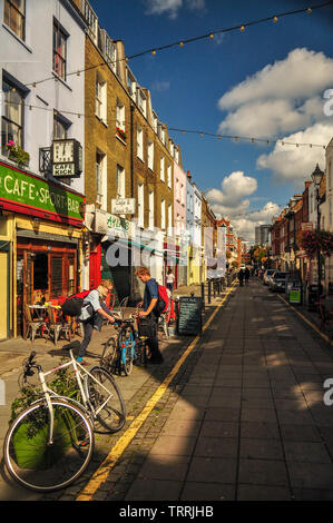 London, England, UK - September 18, 2011: Sun shines on the independent shops and cafes of Exmouth Market in central London. - Stock Photo