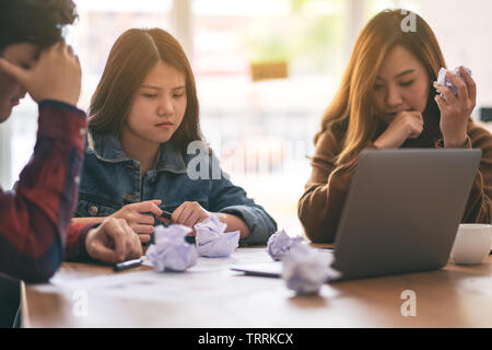 Three businessman get stressed while having a problem in business meeting - Stock Photo
