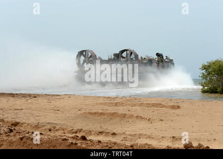 190609-N-WU565-124 - CAMP LEMONNIER, Djibouti - A Landing Craft Air Cushion (LCAC) attached to the San Antonio-class amphibious transport dock ship USS Arlington (LPD-24), slowly drifts into the water to depart Red Beach on base, June 9, 2019. The landing exercise is a requirement to certify the beach, demonstrate capabilities and readiness. Camp Lemonnier is an operational installation that enables U.S., allied and partner nation forces to be where and when they are needed to ensure security in Europe, Africa and Southwest Asia. (U.S. Navy photo by Mass Communication Specialist 2nd Class Orla - Stock Photo