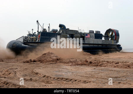 190609-N-WU565-194 - CAMP LEMONNIER, Djibouti - A Landing Craft Air Cushion (LCAC) attached to the San Antonio-class amphibious transport dock ship USS Arlington (LPD-24), inflates landing craft air cushion, and prepares to depart Red Beach on base, June 9, 2019. The landing exercise is a requirement to certify the beach, demonstrate capabilities and readiness. Camp Lemonnier is an operational installation that enables U.S., allied and partner nation forces to be where and when they are needed to ensure security in Europe, Africa and Southwest Asia. (U.S. Navy photo by Mass Communication Speci - Stock Photo