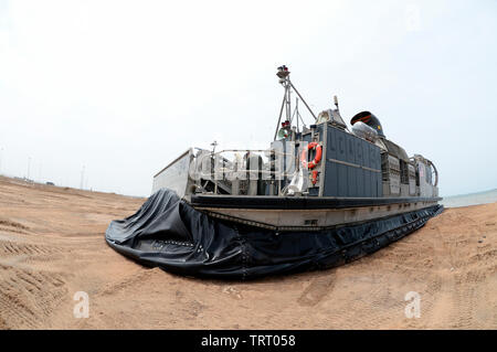 190609-N-WU565-235 - CAMP LEMONNIER, Djibouti - A Landing Craft Air Cushion (LCAC) attached to the San Antonio-class amphibious transport dock ship USS Arlington (LPD-24), conducts a systems check after making landfall at Red Beach on base, June 9, 2019. The landing exercise is a requirement to certify the beach, demonstrate capabilities and readiness. Camp Lemonnier is an operational installation that enables U.S., allied and partner nation forces to be where and when they are needed to ensure security in Europe, Africa and Southwest Asia. (U.S. Navy photo by Mass Communication Specialist 2nd - Stock Photo