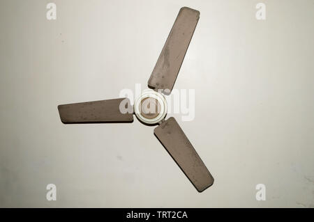 Antique and old electronic metal ceiling fan with three blades in vintage house Isolate on white background. - Stock Photo