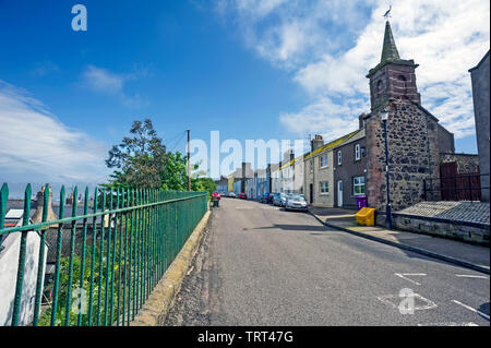 Traditional colourful terraced houses in the past belonging to fishermen's families, Ferryden, Montrose, Angus, Scotland, UK with green metal railings. - Stock Photo