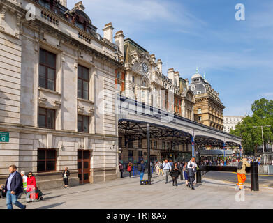 London cityscape: exterior façade and entrance canopy of London Victoria Station, City of Westminster, London, UK, a major transport terminus - Stock Photo
