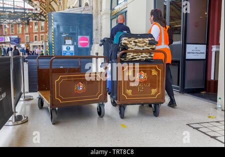 Pullman baggage luggage trollies with suitcases at the entrance to the Belmond Venice Simplon Orient Express departure lounge, London Victoria station - Stock Photo