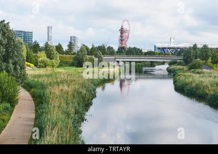 The Northern Parklands in the London Olympic Park, Stratford, looking South towards the London Stadium, along the River Lea - Stock Photo