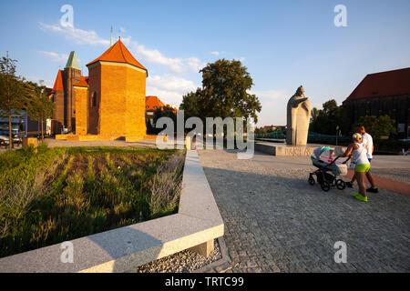 The St Martin church in Ostrow Tumski and Pope John XXIII Granite Statue. Wroclaw Ostrow Tumski. - Stock Photo