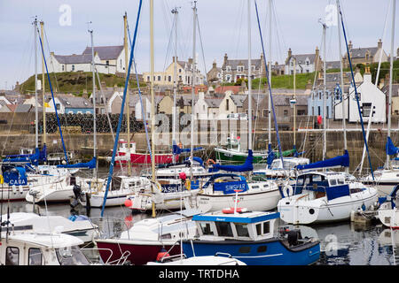 Boats moored in harbour of fishing village on Moray Firth coast. Findochty, Morayshire, Scotland, UK, Britain - Stock Photo