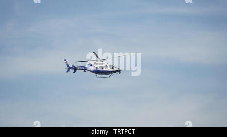 Turkish Police helicopter in action over istanbul, Turkey - Stock Photo