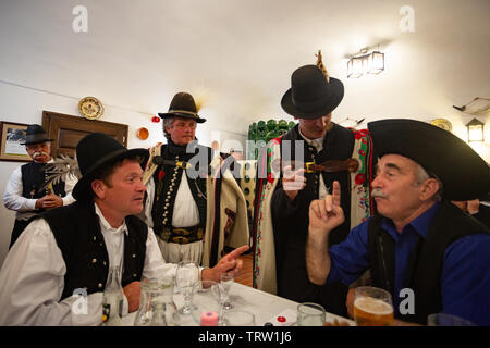 Traditional shepherds are singing folk songs in an old restaurant in Hortobagy, Hungary - Stock Photo