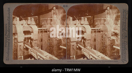 'English: Final rolling mill action forming finished steel rails.; English: Underwood & Underwood Stereographs of Manufacturing Industries,  Set 6 - R - Stock Photo