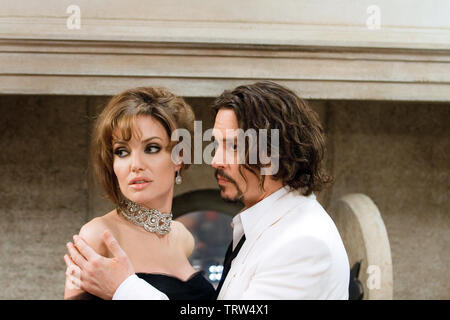JOHNNY DEPP and ANGELINA JOLIE in THE TOURIST (2010). Copyright: Editorial use only. No merchandising or book covers. This is a publicly distributed handout. Access rights only, no license of copyright provided. Only to be reproduced in conjunction with promotion of this film. Credit: GK FILMS / Album - Stock Photo