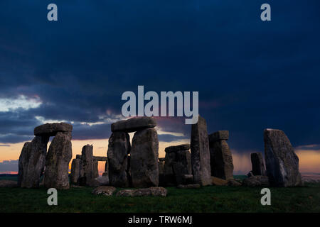 Stonehenge,rain,storm,weather,Solstice, sun,beams,storm,rain, dramatic,Neolithic, Stone, Circle, Stonehenge, Wiltshire, England, UK, - Stock Photo
