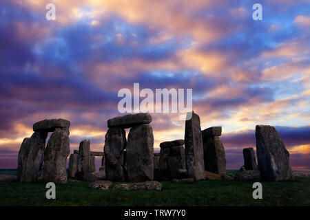 Amesbury, clouds, sunrise,Solstice, sun,beams,storm,rain, dramatic,Neolithic, Stone, Circle, Stonehenge, Wiltshire, England, UK, - Stock Photo