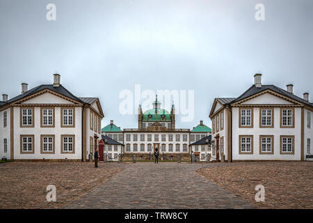 FREDENSBORG, DENMARK - MAY 18, 2019: Fredensborg Palace is a palace located on the eastern shore of Lake Esrum in Fredensborg on the island of Zealand - Stock Photo