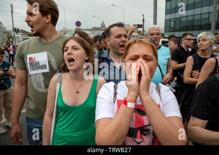 Moscow, Russia. 12th June, 2019 Protesters gather as they take part in unauthorized march to protest against the alleged impunity of law enforcement agencies in central Moscow on June 12, 2019 - Stock Photo