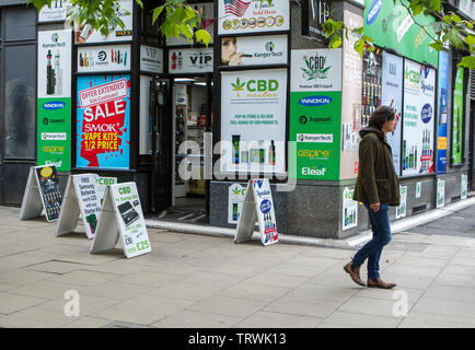 A cbd oil vape store selling vape liquid and cannabis oil base products in Manchester, Piccadilly, UK - Stock Photo