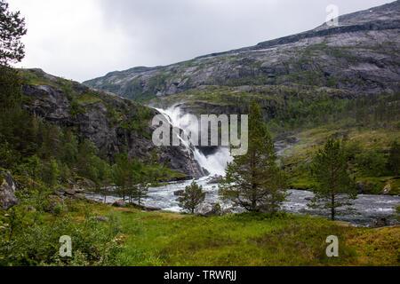 Waterfall Nykkjesøyfossen at Husedalen in Norway, near Kinsarvik on the hiking trail to four waterfalls - Stock Photo