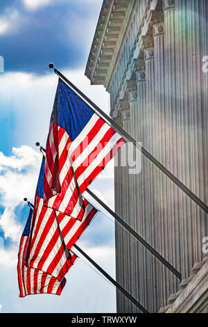 American Flags Herbert Hoover Building Commerce Department 14th Street Washington DC.  Building completed in 1932. - Stock Photo