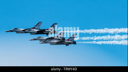 Wantagh, New York, USA - 24 May 2019: Side view of The Thunderbirds flying f-16s very close together in the diamond formation for free air show at Jon - Stock Photo