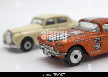 Two vintage collectable matchbox toy car, isolated on white background, close-up - Stock Photo