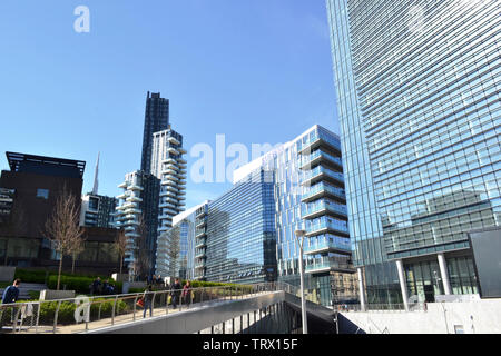 Milan/Italy - March, 28, 2015: Modern highly technological look of the new managerial district Porta Nuova and view to garden and passage. - Stock Photo