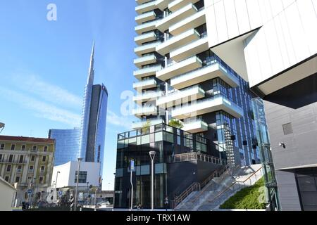 Milan/Italy - March, 28, 2015: Modern highly technological look of a new residence part of Porta Nuova district and Unicredit skyscraper in background - Stock Photo
