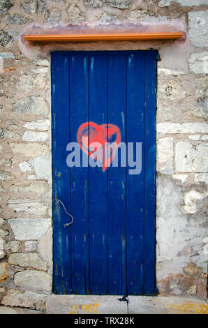 Blue door with red heart - Stock Photo