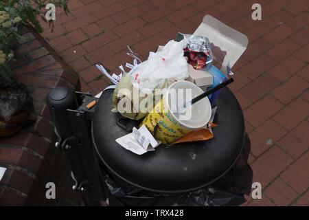 Rubbish in overflowing public bin. Wittmund. East Frisia. Germany - Stock Photo