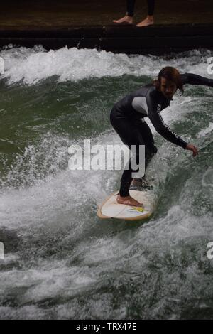 Surfers on the river in Munich - Stock Photo