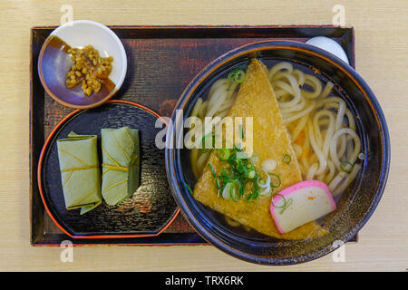 Udon noodles with sushi for lunch at traditional restaurant in Nara, Japan. - Stock Photo