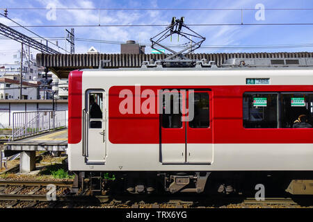 Osaka, Japan - Apr 12, 2019. A local train coming to the JR station in Osaka, Japan. Trains are a very convenient way for visitors to travel around Ja - Stock Photo