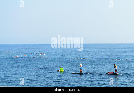 Paddle boarding in Petrovac, Montenegro. - Stock Photo