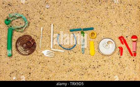 Pollution text made from real single use plastic rubbish found on beach - Stock Photo