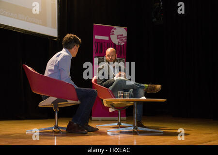 Joy Division and New Order drummer Stephen Morris interviewed by Hackney's Mayor Philip Glanville on stage at the Stoke Newington Literary Festival - Stock Photo