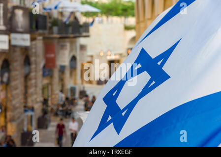 Flag of Israel Flag of Israel near the old city. - Stock Photo