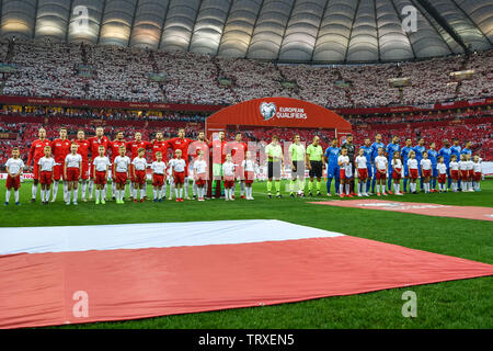WARSAW, POLAND - JUNE 10, 2019: Qualifications Euro 2020  match Poland - Israel 4:0. Team of Poland (L) and Israel (R) during anthem. - Stock Photo